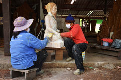 Senior sculptors work on his sculpture in his workshop Royalty Free Stock Photography