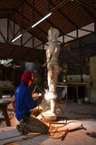 Senior sculptors work on his sculpture in his workshop Stock Photo
