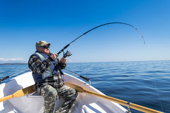 Senior sea fishing action Royalty Free Stock Photo