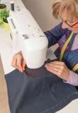 Senior Seamstress Woman Working On Sewing Machine Royalty Free Stock Image