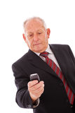Senior sending a sms Royalty Free Stock Photos