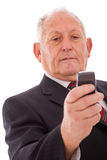 Senior sending a sms Stock Photos