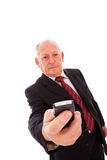 Senior sending a sms Royalty Free Stock Image