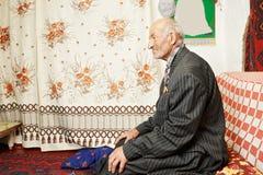 Senior serene man on sofa Stock Image