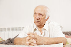 Senior serious man in white shirt Royalty Free Stock Image