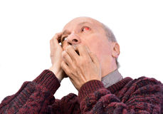 Senior shocked man with irritated red bloodshot eye Stock Photography