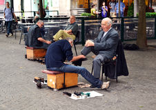 Senior shoeshiners of Porto, Portugal stock photography