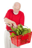 Senior Shopper Checks Basket Stock Photography