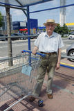 Senior with shopping cart Royalty Free Stock Image