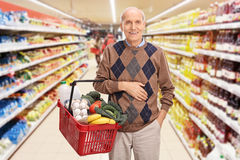 Senior shopping and posing in a supermarket Royalty Free Stock Photo