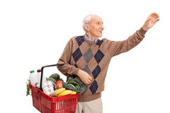 Senior shopping and reaching for something Stock Photo
