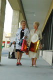 Senior shopping spree. Two senior women shopping together in a plaza Stock Photo