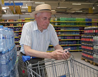 Senior shopping in supermarket Stock Photography