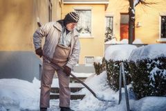 Senior shoveling snow Royalty Free Stock Photography