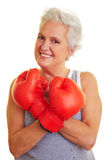 Senior showing off her red boxing Royalty Free Stock Images