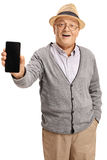 Senior showing a phone to the camera and smiling Stock Photography