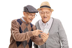 Senior showing something on phone to a friend. Senior gentleman showing something on his cell phone to his friend isolated on white background Royalty Free Stock Photo