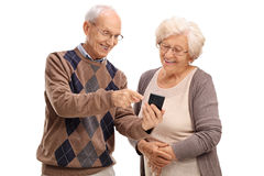 Senior showing something to his wife Royalty Free Stock Photo