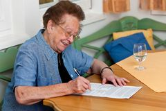 Senior signs a contract Stock Image