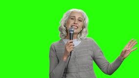 Senior singer woman on green screen. stock footage