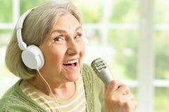 Senior singer woman Royalty Free Stock Photo