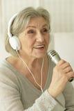 Senior singer woman Stock Photo