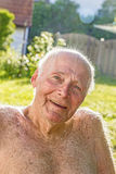 Senior sits in the chair in the garden Stock Photography