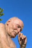 Senior sits in the chair in the garden Royalty Free Stock Image