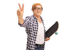 Senior skater making a peace sign Stock Photos
