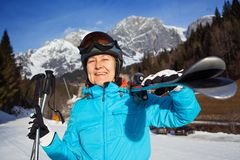 Senior skier. Closeup of smiling senior skier woman wearing helmet and goggles Stock Photography