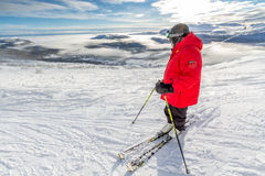 Senior skier looking down the valley Stock Images