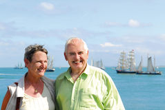 Senior smiling couple with scenic ocean Stock Photography