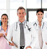 Senior Smiling doctor with his colleagues Royalty Free Stock Photography