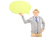 Senior smiling gentleman holding an empty speech bubble Stock Images