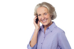 Senior smiling lady attending phone call Stock Photos