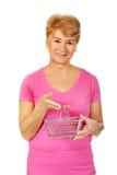Senior smiling woman holding mini shopping basket Royalty Free Stock Image