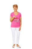 Senior smiling woman holding mini shopping basket Royalty Free Stock Photography