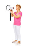 Senior smiling woman screaming through a megaphone Stock Photography