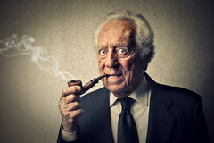 Senior smoking Royalty Free Stock Photo