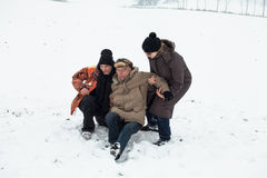 Senior snow accident and people helping Stock Photography