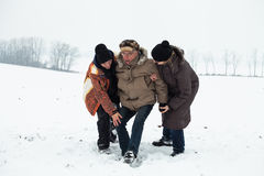 Senior snow accident and people helping him Royalty Free Stock Photos
