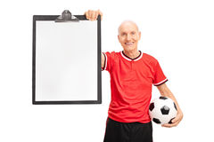 Senior soccer coach holding a clipboard Royalty Free Stock Photos