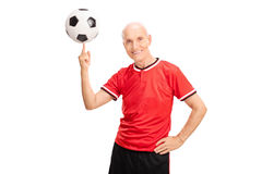 Senior spinning a football on his finger Royalty Free Stock Photography