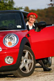 Senior in sports car. Senior in a red sports car (MINI Cooper stock photo
