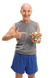 Senior in sportswear holding a salad royalty free stock photography