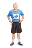Senior in sportswear with a race number on his chest Royalty Free Stock Photography