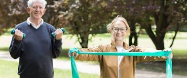 Senior sporty pair exercising Royalty Free Stock Photos