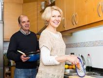 Senior spouses at modern kitchen Royalty Free Stock Photography