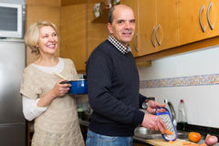 Senior spouses at modern kitchen Royalty Free Stock Images