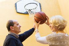 Senior spouses throwing the ball Royalty Free Stock Photography